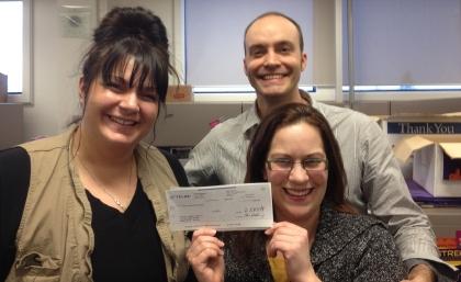 Theatre Alberta receives cheque from Calgary TELUS Community Board