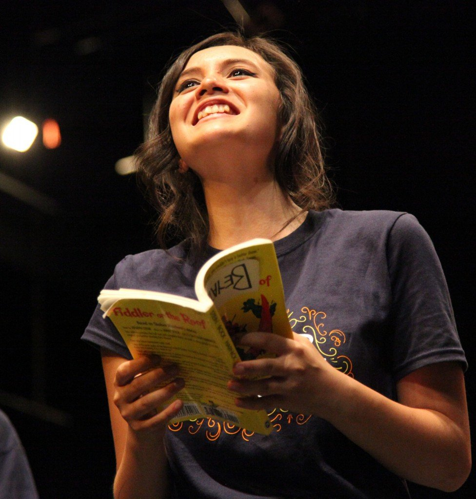 Teenage Girl Shot From Below Reading Monologue Aloud from Fiddler On the Roof Script