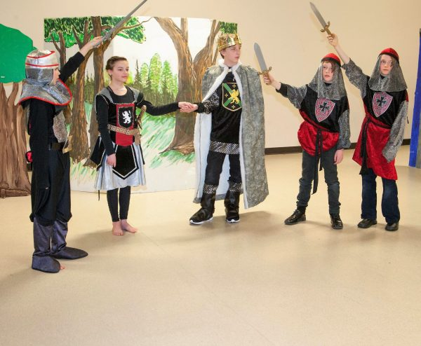 Image of youths dressed as knights.