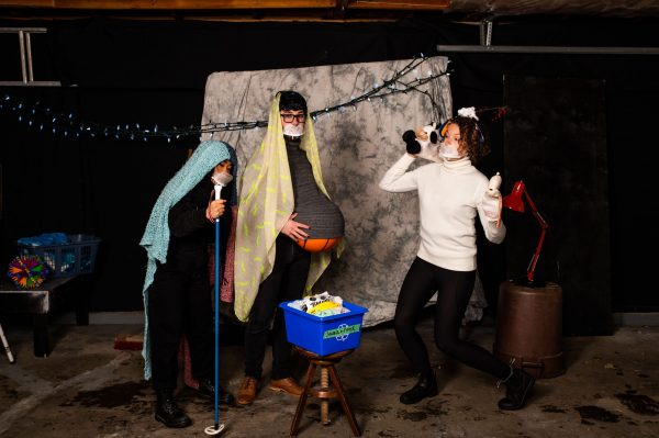 Image of three actors in a comical nativity scene.