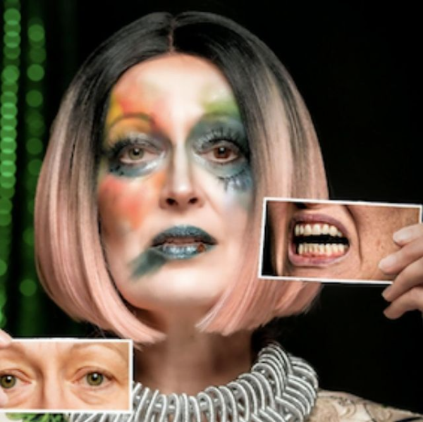 Female presenting actor with heavy smeared make up holding images of eyes and mouth.