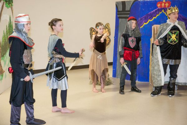 Children dressed in medieval costumes.