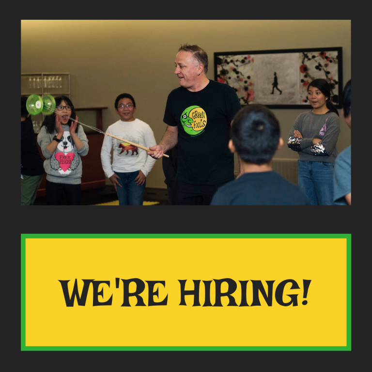 We're hiring banner under photo of teacher and students