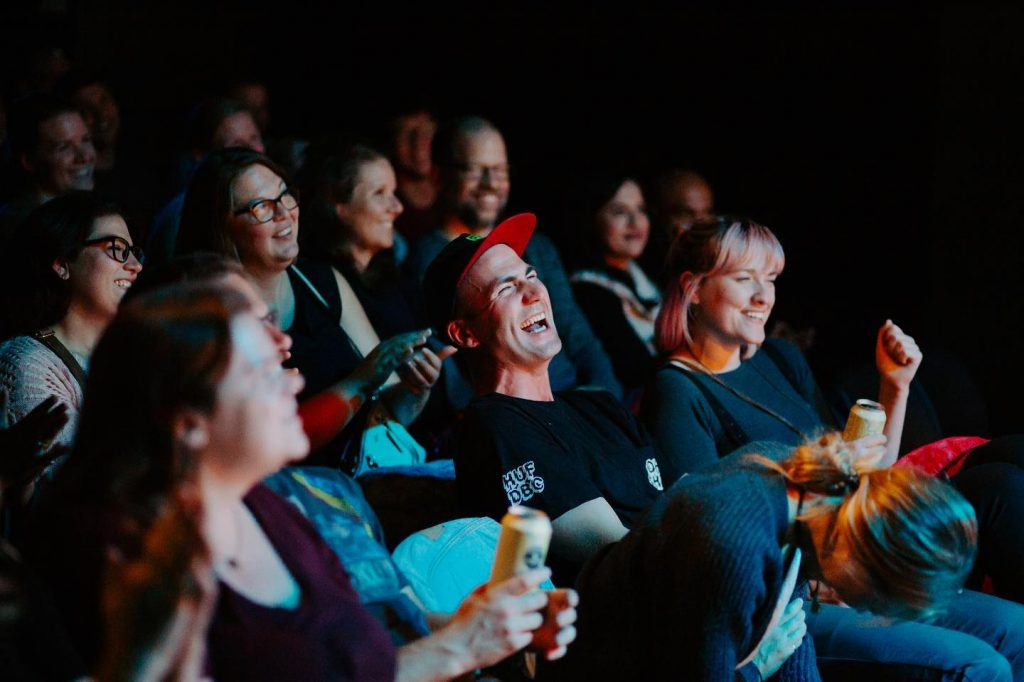 Group of people in a theatre laughing