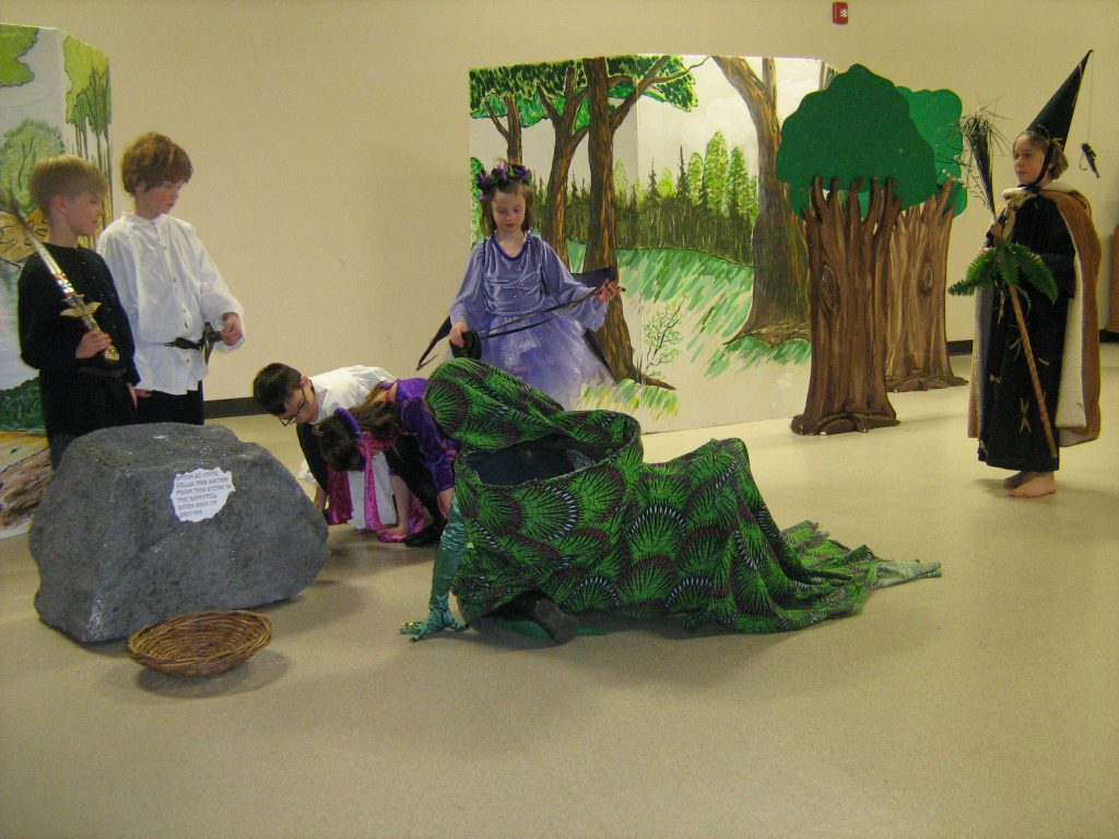 Youths in theatrical costumes performing a scene