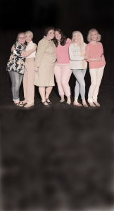 Group of six white women standing together on what may be a cloud